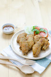 Fired chicken wing on wood plate Stock Photography