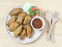 Fired chicken wing on wood plate Stock Photo
