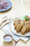 Fired chicken wing on wood plate Royalty Free Stock Image
