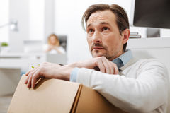 Fired depressed employee sitting on the floor in the office stock photo