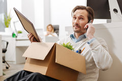 Fired depressed employee using the gadget in the office royalty free stock image