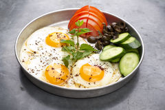 Fired eggs presentation with mints, tomato, olive, cucumber and sumac Royalty Free Stock Photo