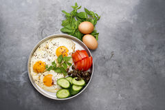 Fired eggs presentation with mints, tomato, olive, cucumber and sumac Royalty Free Stock Photos