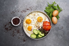Fired eggs presentation with mints, tomato, olive, cucumber and sumac Stock Photography