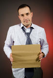 Fired employee. Holding empty sign in hand Royalty Free Stock Images