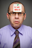 Fired from job. Adult businessman fired from work by a sticker note Stock Photos