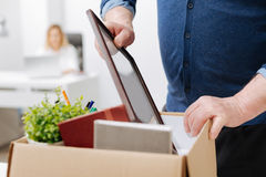 Fired man gathering personal belongings into the box Stock Images