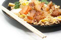 Fired noodle and chopsticks Royalty Free Stock Images