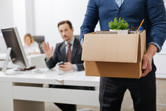 Fired senior employee leaving the office with the box. Moving to the next level. Concentrated involved senior employee standing and holding the box with his Royalty Free Stock Photography