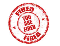 Fired stamp. Grunge rubber stamp with the text you are fired written inside Royalty Free Stock Photography