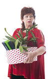 Fired woman carrying a box of personal items Royalty Free Stock Image