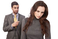 Fired at work. Young women fired, with angry boss standing in the background Stock Image