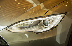 FIREDRICHSHAFEN, GERMANY - APRIL 20, 2016: The Tesla Motors Inc.. Front view of the xenon headlights Mdel S electric vehicle disp Royalty Free Stock Images