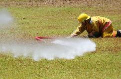 Firefighter. Captures a stray live fire hose stock image