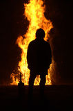 Firefighter. And roaring blaze at night Stock Images