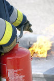 Firefighter. Using fire extinguisher during training royalty free stock images