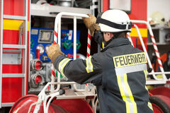 Firefighter. Picture from a young and successful firefighter at work Stock Photography