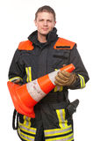 Firefighter. Picture from a young and successful firefighter at work Royalty Free Stock Photography