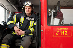 Firefighter. Picture from a young and successful firefighter at work Royalty Free Stock Photo