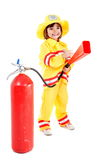 Firefighter. Young child as firefighter holding a fire extinguisher Royalty Free Stock Photography