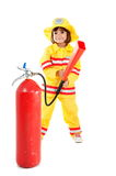 Firefighter. Young child as firefighter holding a fire extinguisher Stock Photo