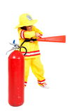 Firefighter. Young child as firefighter holding a fire extinguisher Royalty Free Stock Image