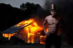 Firefighter. Young attractive male firefighter at a fire Stock Photo