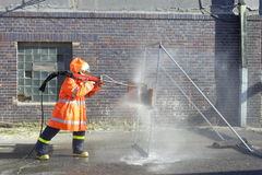 Firefighter. Training with water cut Royalty Free Stock Photo