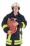 A firefighter. With his tools and equipment Royalty Free Stock Image