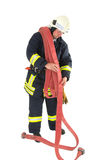 A firefighter. With his tools and equipment Stock Photography