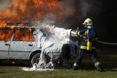 Firefighter in action Stock Image