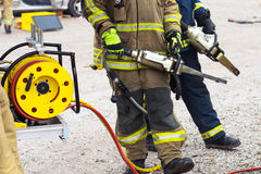 Firefighter in action Stock Photography