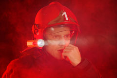 Firefighter in action using walkie-talkie Stock Image