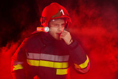 Firefighter in action using a walkie-talkie Stock Images