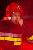 Firefighter in action using walkie-talkie Royalty Free Stock Photo