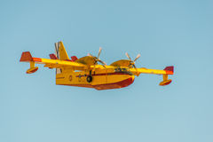 Firefighter airplane on sky Stock Image