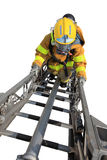 Firefighter. Ascends upon a one hundred foot ladder Stock Photography