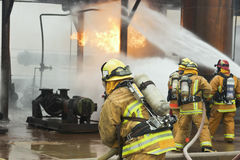 Firefighter Assist Stock Images