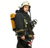 Firefighter with axe and oxygen balloon Royalty Free Stock Photography