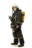 Firefighter with axe and oxygen balloon Royalty Free Stock Images