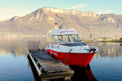 Firefighter boat moored at the dock Stock Photos