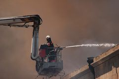 Firefighter on a boom. During fire royalty free stock images