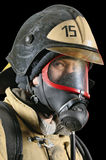 Firefighter in breathing apparatus. Portrait of a firefighter in breathing apparatus on a black background royalty free stock photos