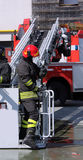 Firefighter in the cage of fire engine Stock Images