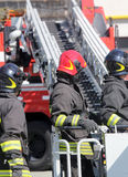 Firefighter in the cage of fire engine Stock Image