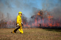 Firefighter. Clermont, Kentucky � October 22, 2015: Firefighters manage a controlled burn at Bernheim Arboretum and Research Forest in Clermont, Kentucky, on Stock Photography