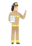 Firefighter with clipboard giving thumb up. Caucasian firefighter holding clipboard and giving thumb up. Full length of firefighter with clipboard. Firefighter Royalty Free Stock Images