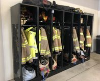 Firefighter coats ready for action. Firefighter gear is called turnouts. This includes the coat, pants, and helmets. Each firefighter has his or her own set of stock photo