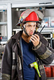 Firefighter Conversing On Walkie Talkie Royalty Free Stock Images
