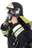 Firefighter corrects overview mask breathing apparatus. Isolated on white stock images